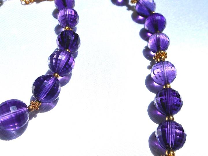 Amethyst Necklace & Bracelet Beads in Sun on White Satin