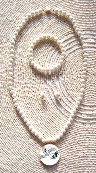 Pearl Necklace Set in Window Sun